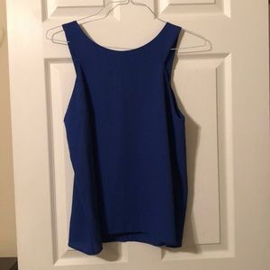 Blue blouse, half zip in the back